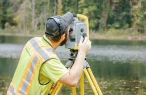 civil engineer surveying a river